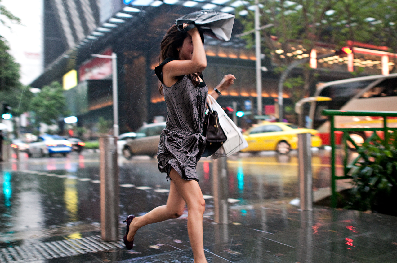 A girl Running in Rain