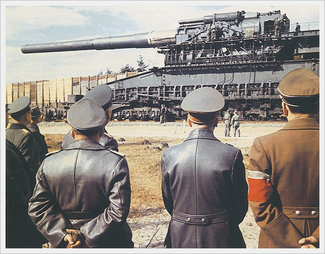 Hitler looking at the Gustav Railway gun (1942)