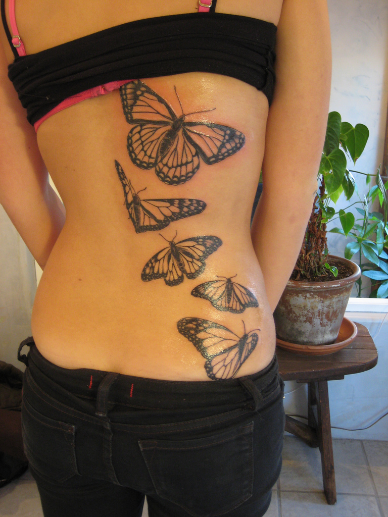 Awesome 3D lower back tattoo
